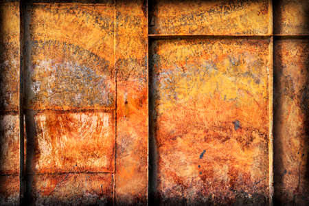 rust covered: Old, scrapped, badly corroded Metal river boat bottom surface, reinforced with metal ribs, covered with cracked decomposed layers of paint and rust, vignette texture. Stock Photo