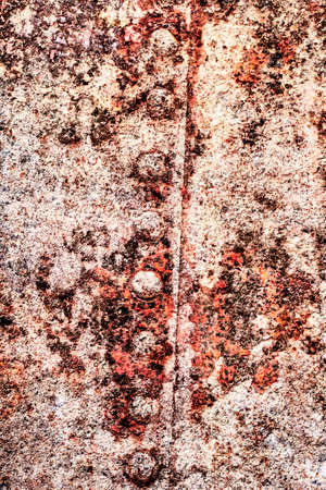 Old, scrapped, badly corroded river raft hut floater riveted metal surface, covered with cracked decomposed layers of tar, paint and rust. Stock Photo