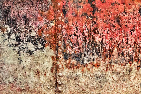 rust covered: Old, scrapped, badly corroded river raft hut floater riveted metal surface, covered with cracked decomposed layers of tar, paint and rust. Stock Photo