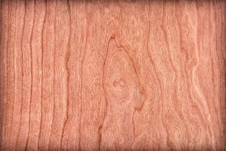 cherry hardwood: Photograph of Reddish-brown Cherry Wood Veneer vignette, grunge texture sample.