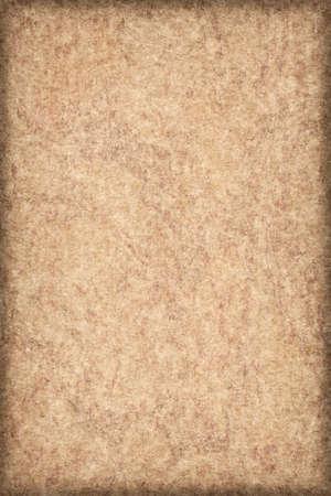 vellum: Photograph of Antique Ocher Paper Vellum coarse grain, bleached, mottled, vignette grunge texture sample.