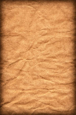 Photograph of old Recycle Kraft Brown Paper, coarse grain, crushed crumpled, vignette grunge texture sample. Stock Photo