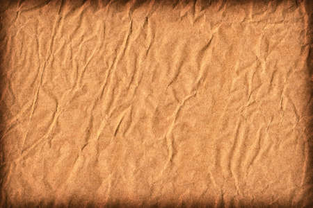 impurities: Photograph of old Recycle Kraft Brown Paper, coarse grain, crushed crumpled, vignette grunge texture sample. Stock Photo