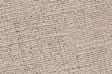 unrefined: Artist Jute raw Canvas, unrefined, non caulked, unsealed, single Acrylic primed, extra coarse, grunge texture sample. Stock Photo
