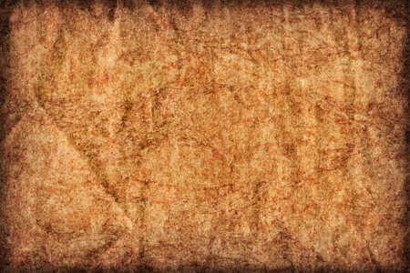 mottled: Recycle Kraft Brown Paper, coarse grain, crushed crumpled, stained, mottled, vignette grunge texture sample. Stock Photo