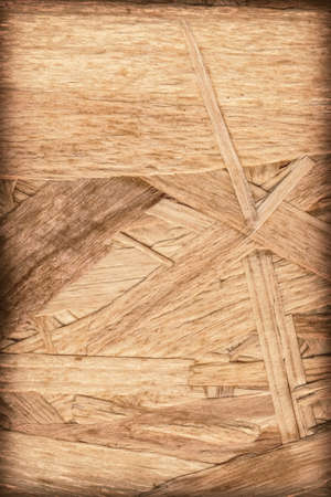 temporal: Wooden chipboard, rough, extra coarse surface vignette grunge texture. Stock Photo