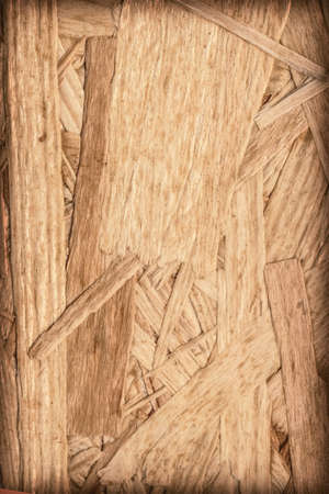 provisional: Wooden chipboard, rough, extra coarse surface vignette grunge texture. Stock Photo