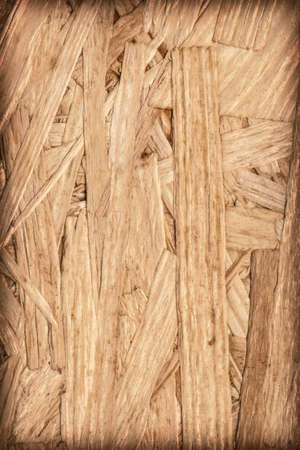 prefabricated buildings: Wooden chipboard, rough, extra coarse surface vignette grunge texture. Stock Photo