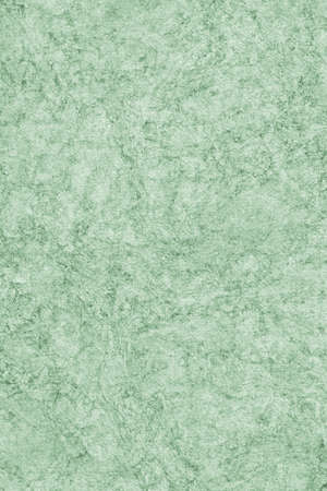 kelly: Photograph of Recycle Watercolor Paper, coarse grain, light Kelly Green, bleached, interspersed with delicate irregular linear pattern, grunge texture.