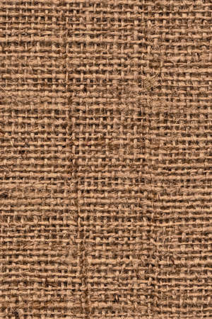 cloth manufacturing: Photograph of raw, roughly woven, coarse grain, burlap grunge texture. Stock Photo