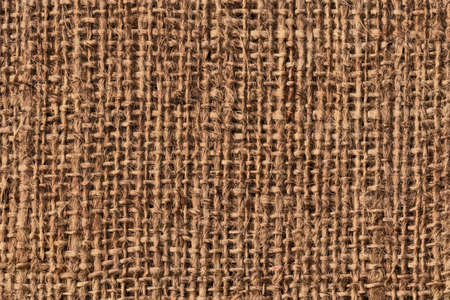 roughly: Photograph of raw, roughly woven, coarse grain, burlap grunge texture. Stock Photo