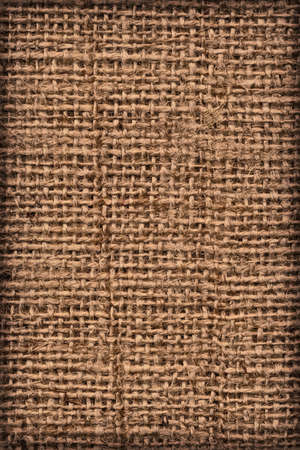 cloth manufacturing: Photograph of raw, roughly woven, extra coarse grain, burlap vignette grunge texture.