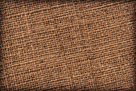 gunny: Photograph of raw, roughly woven, extra coarse grain, burlap vignette grunge texture.