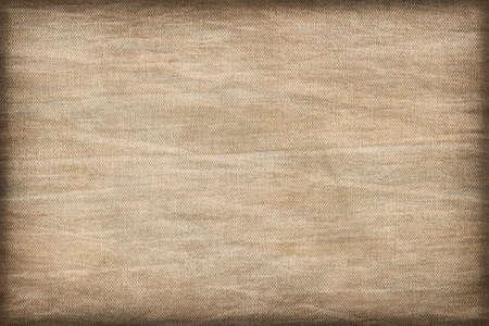 impurities: Artist Beige Primed Linen Duck Canvas, coarse grain, bleached, mottled, stained, vignette grunge texture. Stock Photo