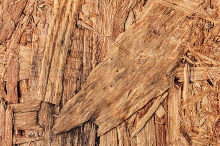 prefabricated buildings: Wooden chipboard reverse side, rough, extra coarse, grunge surface texture detail.