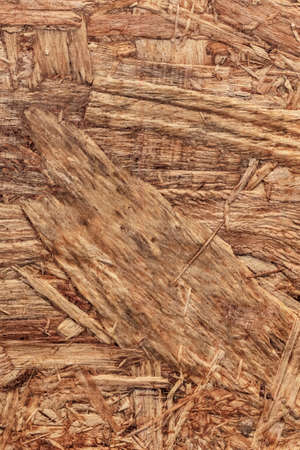 chipboard: Wooden chipboard reverse side, rough, extra coarse, grunge surface texture detail.