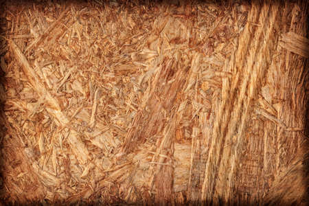 reverse: Wooden chipboard reverse side, rough, extra coarse, vignette surface texture detail.