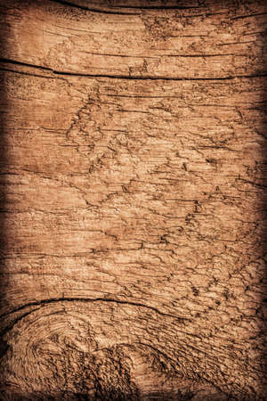 brunt: Photograph of old, roughly treated, weathered, cracked, knotted Pine plank, vignette grunge texture. Stock Photo