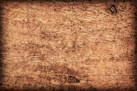 brunt: Photograph of old, roughly treated, weathered, cracked, knotted Pine plank, mottled, stained, vignette grunge texture.
