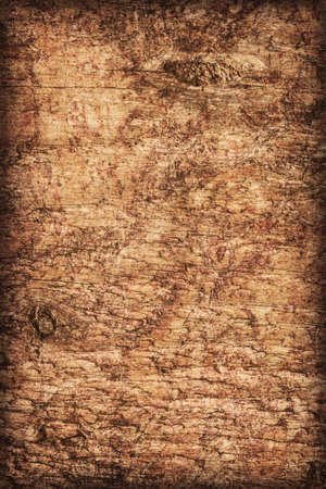 roughly: Photograph of old, roughly treated, weathered, cracked, knotted Pine plank, mottled, stained, vignette grunge texture.