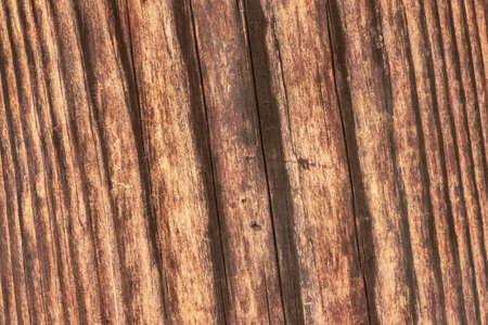 roughly: Photograph of old, roughly treated, weathered, cracked, rotten, knotted Pine plank grunge texture. Stock Photo