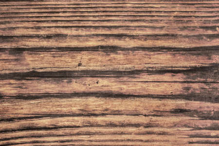 treated: Photograph of old, roughly treated, weathered, cracked, rotten, knotted Pine plank grunge texture. Stock Photo
