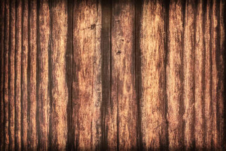 Old, roughly treated, weathered, cracked, rotten, knotted Pine plank, vignette grunge texture. Stock Photo