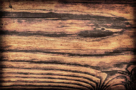 Old, roughly treated, weathered, cracked, rotten, knotted Pine plank, vignette grunge texture. photo