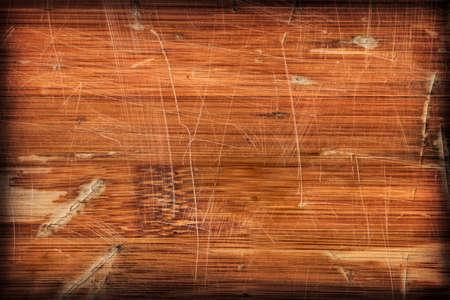 brunt: Photograph of obsolete old, varnished, weathered Wooden Laminated Panel, cracked, scratched, vignette grunge texture.