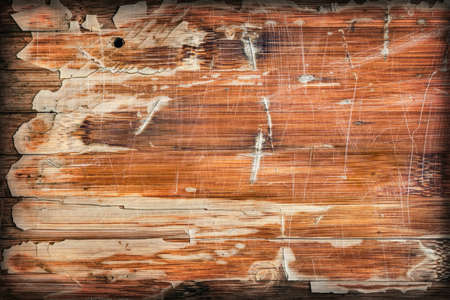 Photograph of obsolete old, varnished, weathered Wooden Laminated Panel, cracked, scratched, vignette grunge texture.