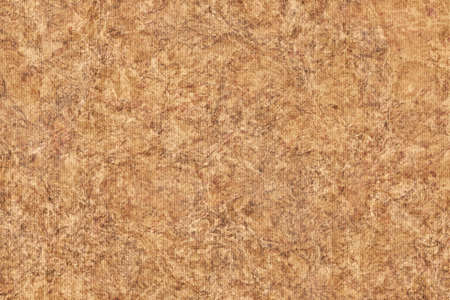 blotted: Photograph of Recycle Striped Ocher Pastel Paper, bleached, mottled, coarse grain, grunge texture sample.
