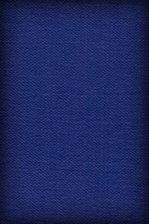 mottled: Photograph of Artist Navy Blue Primed Cotton Duck Canvas coarse, bleached, mottled, vignette grunge texture.