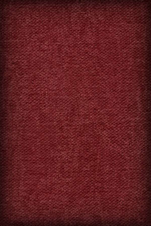 Photograph of Artist Wine Red Primed Cotton Duck Canvas coarse, bleached, mottled, vignette grunge texture.