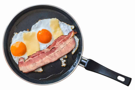 rasher: Single Belly Bacon rasher with two Sunny Side Up Fried Eggs, in frying pan, Isolated on White Background.