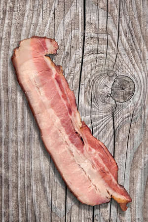 rasher: Pork Belly Rasher, on old knotted Wooden Background. Stock Photo