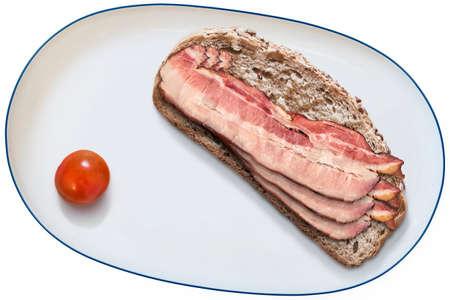 bread slice: Integral Bread slice with Pork Belly Rashers Sandwich and Cherry Tomato alongside, on White Porcelain Platter, Isolated On White Background.