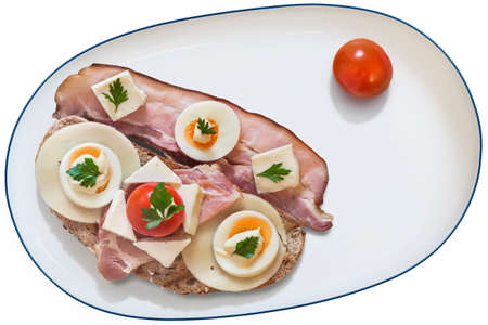rasher: Toast Sandwich in white Porcelain Platter, with Ham, Cheese, hard boiled Egg slices, Mayonnaise and Parsley leaves, some extra Pork Rasher, and Cherry Tomato, isolated on White Background.