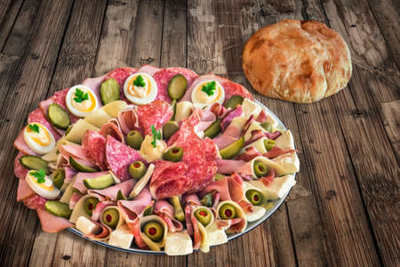 peeledoff: Plate of Serbian Meze with domestic Pita Bread loaf, placed on very old, weathered, cracked, scratched, peeled off, Wooden Table. Stock Photo