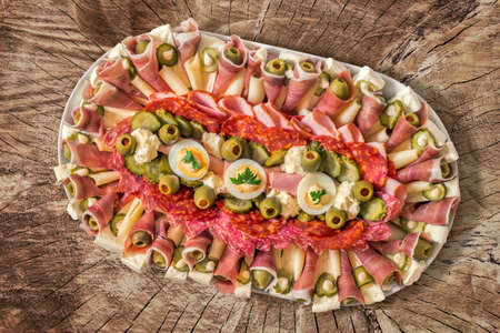 plateful: Plateful of Appetizer Meze placed on old Log Cross Section Surface