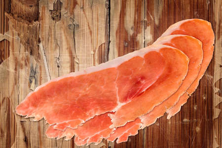 peeledoff: Prosciutto Slices on very old, varnished, cracked, peeled off, scratched Wooden Table Surface