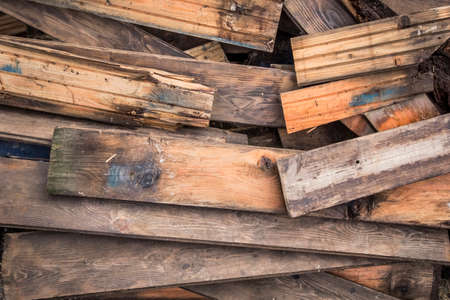 floorboards: Photograph of old, rotten, scrapped floorboards and decking planks amassed and scattered in a untidy heap. Stock Photo
