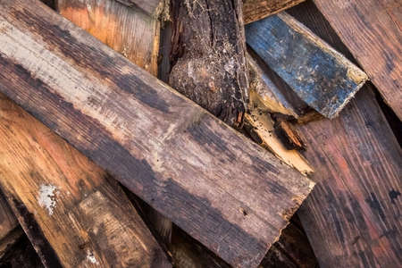 softwood: Photograph of old, rotten, scrapped floorboards and decking planks amassed and scattered in a untidy heap. Stock Photo