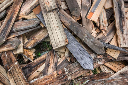 untidy: Photograph of old, rotten, scrapped floorboards and decking planks amassed and scattered in a untidy heap. Stock Photo