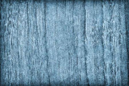 dark blue: Walnut Wood Bleached and Dark Blue Stained Vignette Grunge Texture.