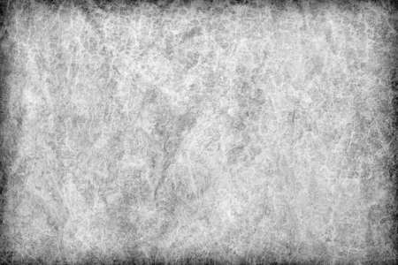 parchment texture: Photograph of old Gray animal skin parchment, creased, coarse, vignette grunge texture sample.
