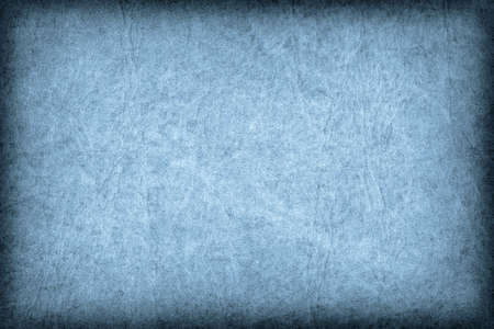 vellum: Photograph of old Blue animal skin parchment, creased, coarse, vignette grunge texture sample. Stock Photo