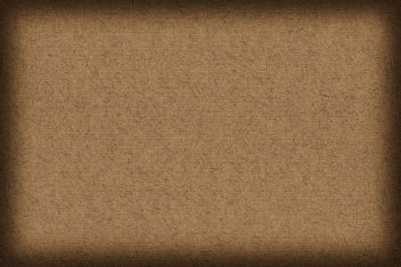 umber: Photograph of recycle, striped Kraft Raw Umber Brown Paper, coarse grain vignette grunge texture.