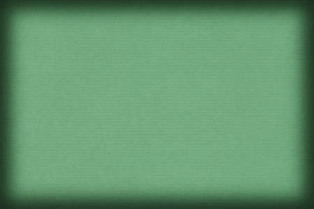 kelly: Photograph of old recycle, striped Kraft Pale Kelly Green Paper, coarse grain vignette grunge texture. Stock Photo