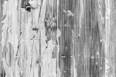 drilled: Photograph of obsolete old, weathered, varnished Wooden Laminated Panel, BW, cracked, scratched, grunge texture. Stock Photo
