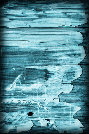drilled: Old Cyan Stained Varnished Wooden Laminated Panel, Weathered, Cracked, Scratched Vignette Grunge Texture.